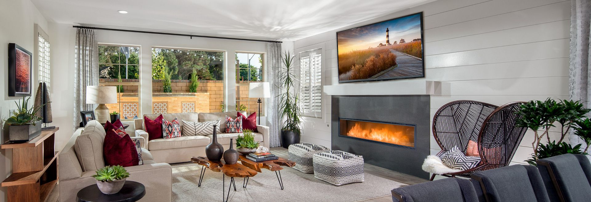 Plan 2 Living Room with fireplace and large windows