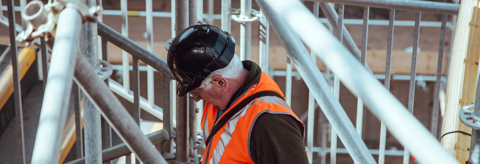 Construction worker inspecting work that has been done