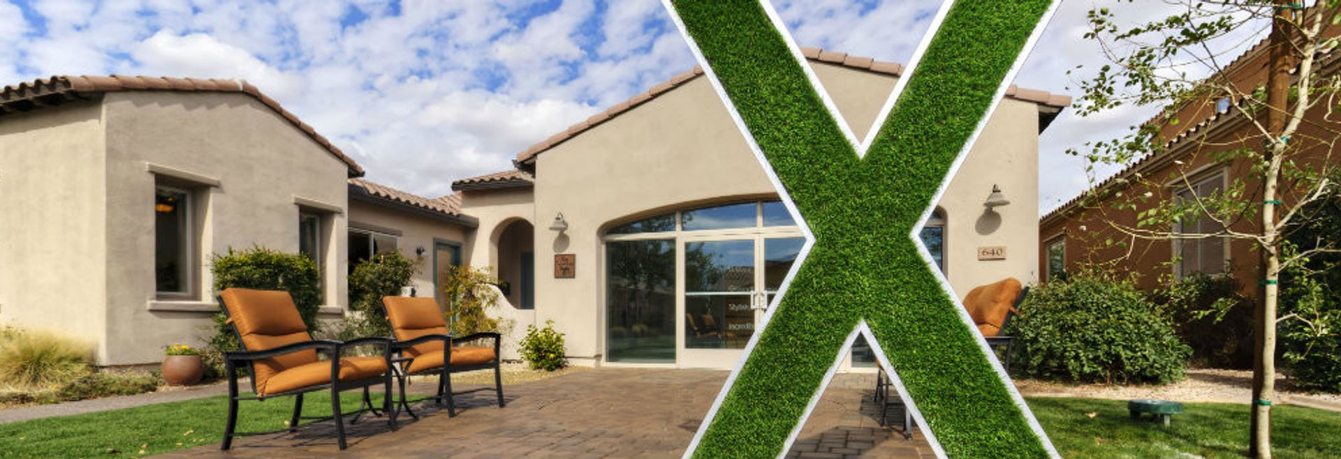 Home exterior with an X made of grass