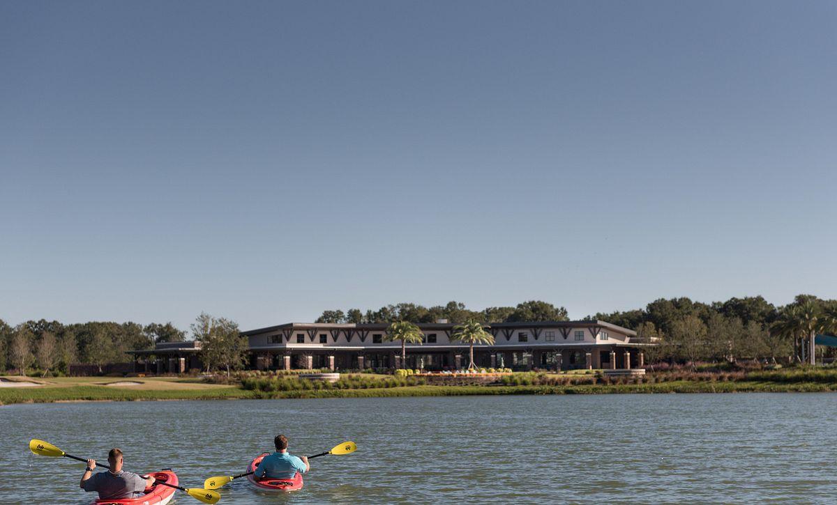 2 men in kayaks on Reflection Lake