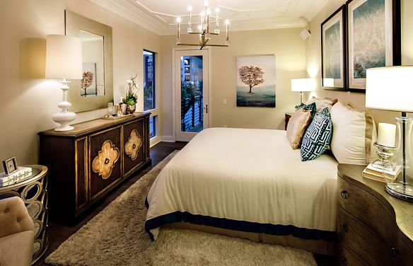 Plan 2X master bedroom with bed, area rug, wood floors, dresser, night stands, and table lamps