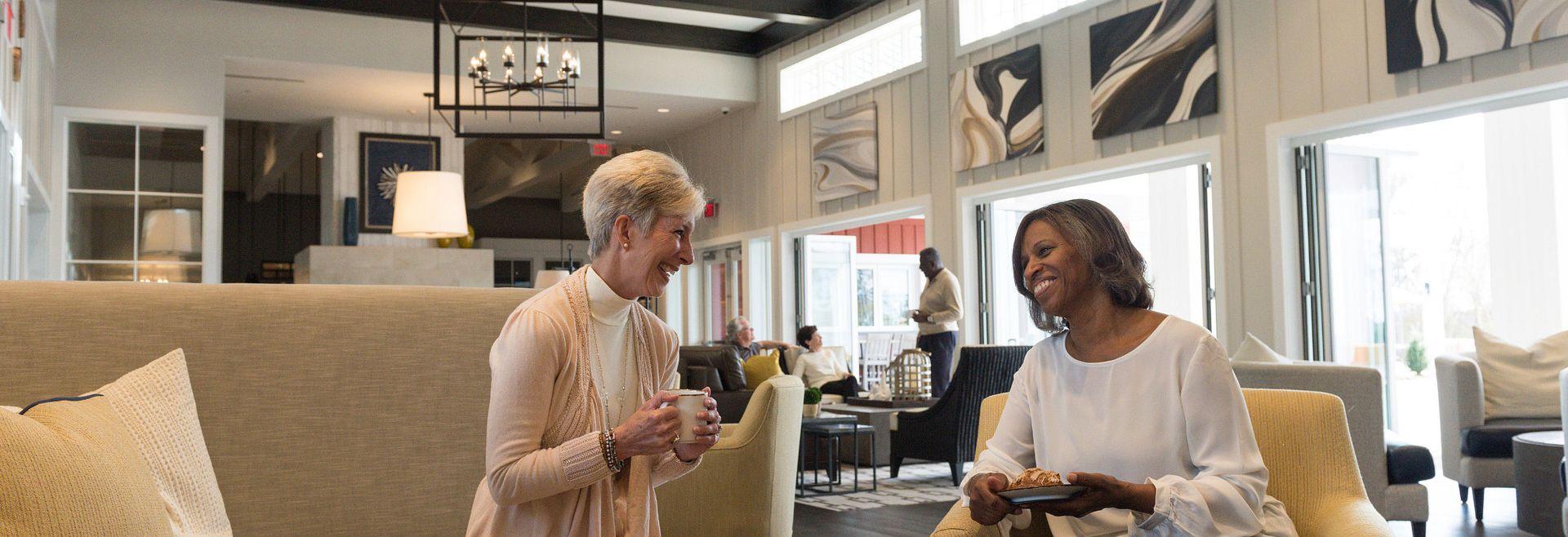 Ladies enjoying coffee in the Grand Living Room