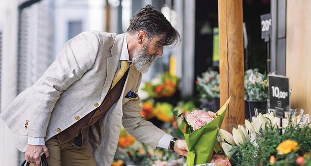 Lifestyle Image of man buying flowers