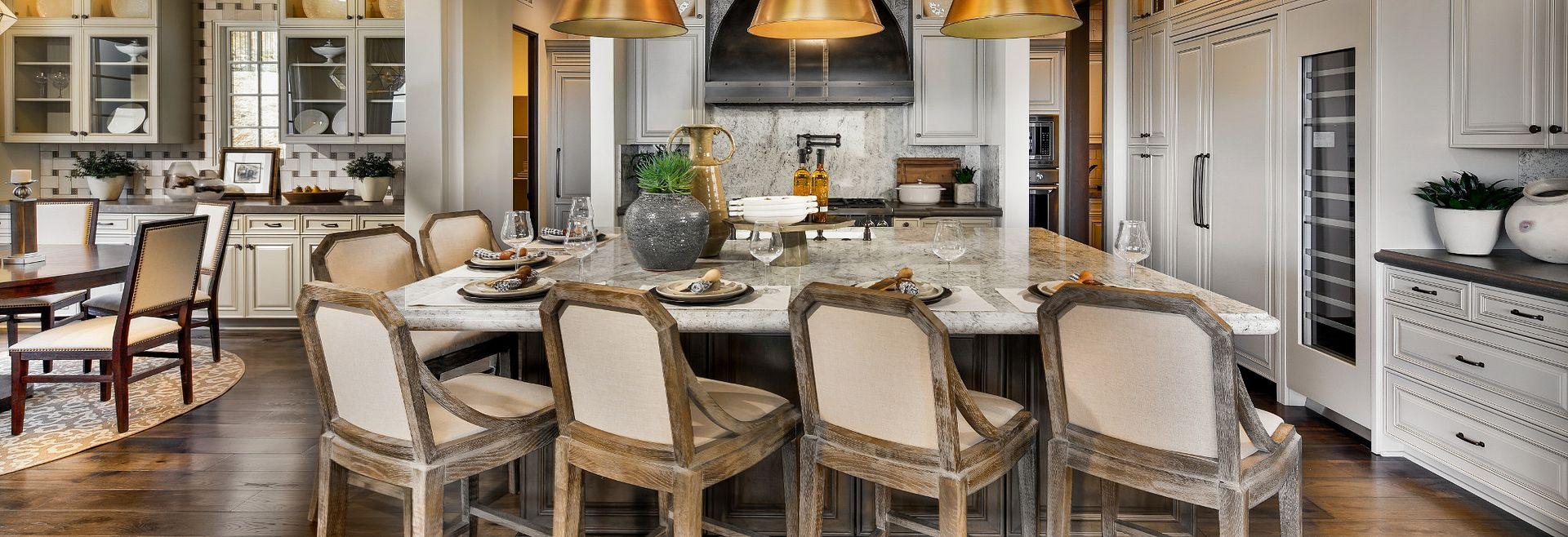 Plan 7 Kitchen with pendant lighting, barstool chairs, and large island