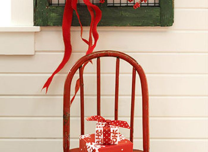 Wrapped gifts sitting on a wooden chair