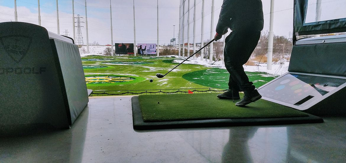 Topgolf player in bay