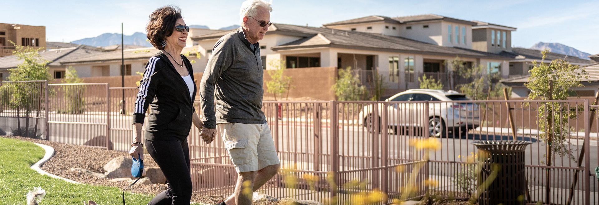 Couple Walking the dog at Trilogy in Summerlin by Shea Homes in Las Vegas, NV