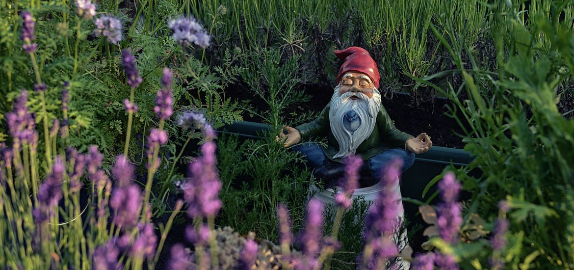Garden gnome in a meditation pose.