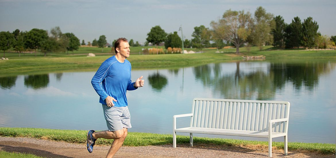 Man Running in Park at Reunion
