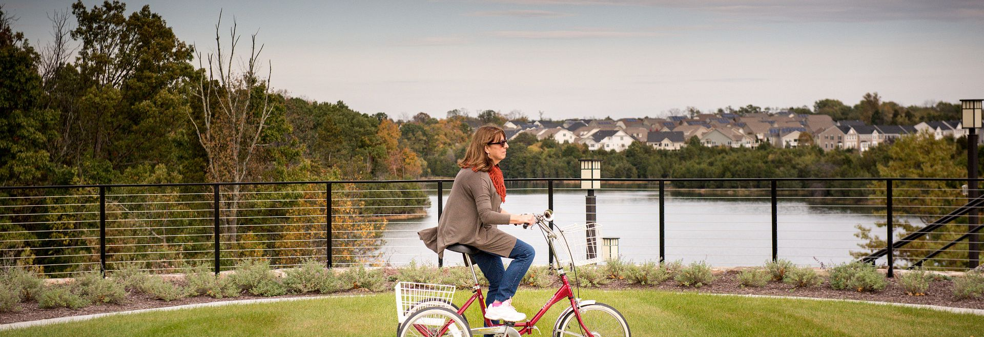 Woman riding a bike at Trilogy Lake Frederick