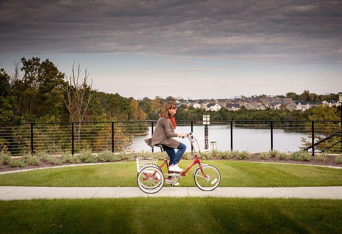 Lady on a bike by lake