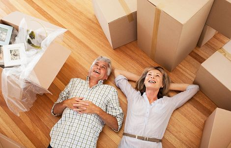 Couple laying down surrounded by boxes