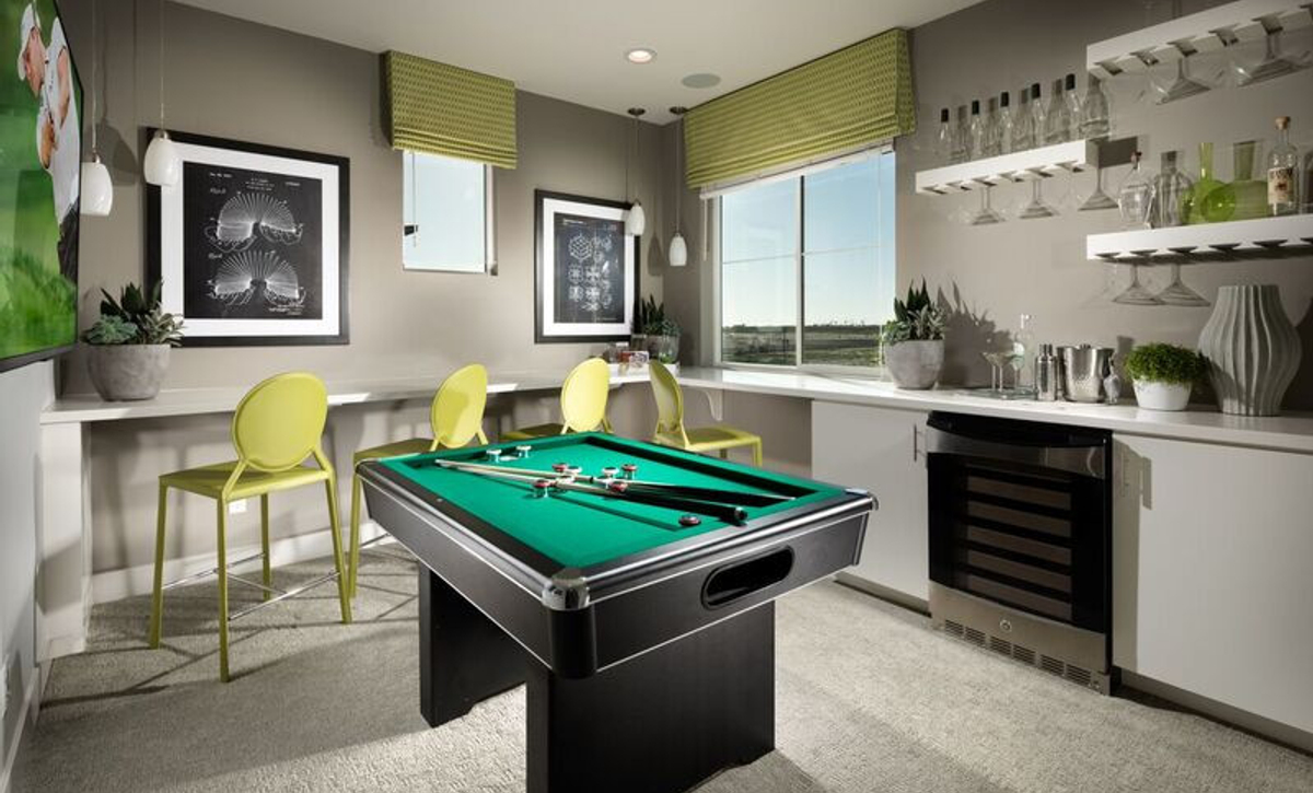 Plan 3 loft with pool table, office desk, and office chair