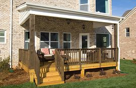 Rear covered porch with wooden columns