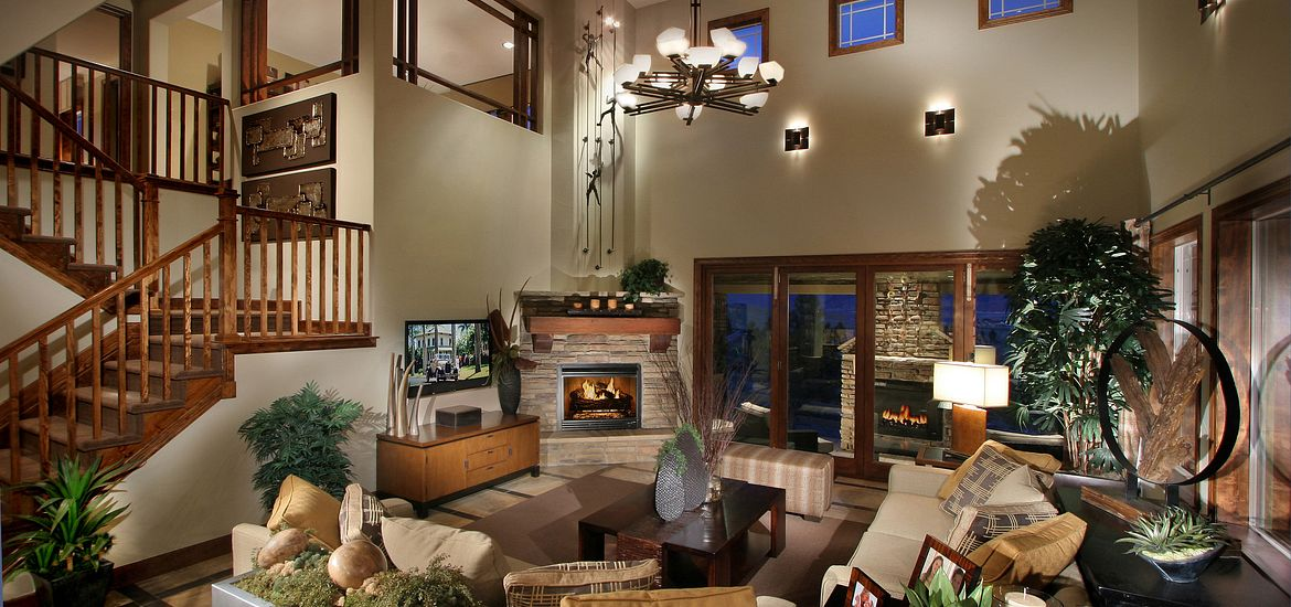 Great room with fireplace and couches.