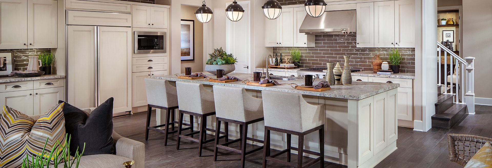 Residence 2 open kitchen with granite counter-tops, creamy white cabinets, recessed lighting, and pendant lighting