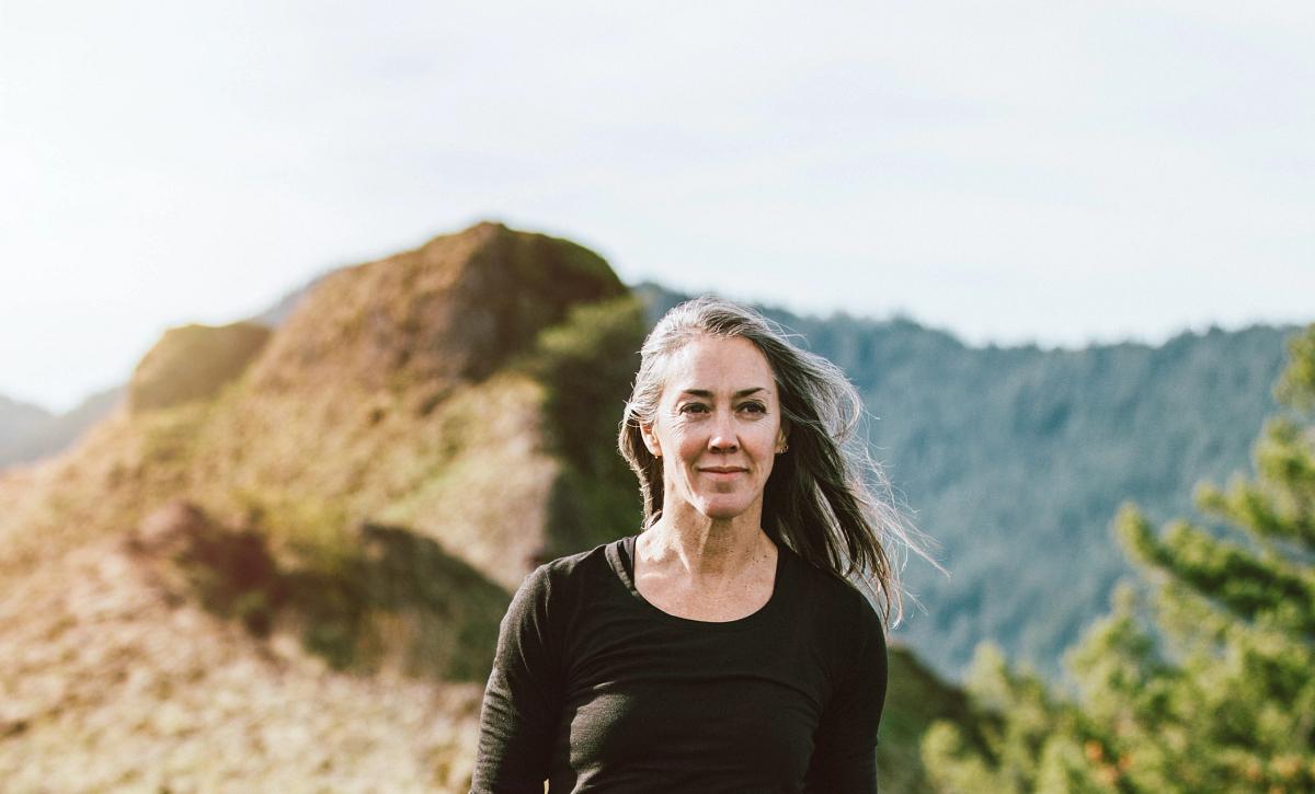 Gal hiking on a mountain