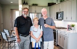 group at a model home grand opening event