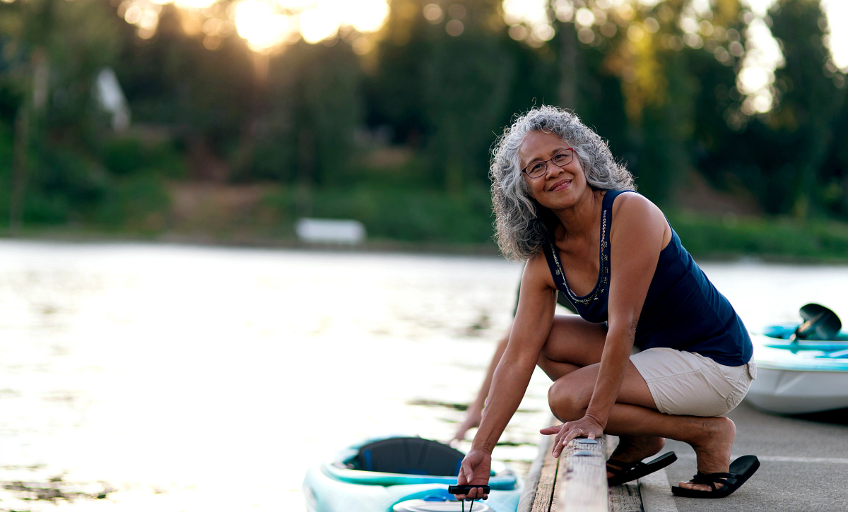 woman at the dock with a kayak