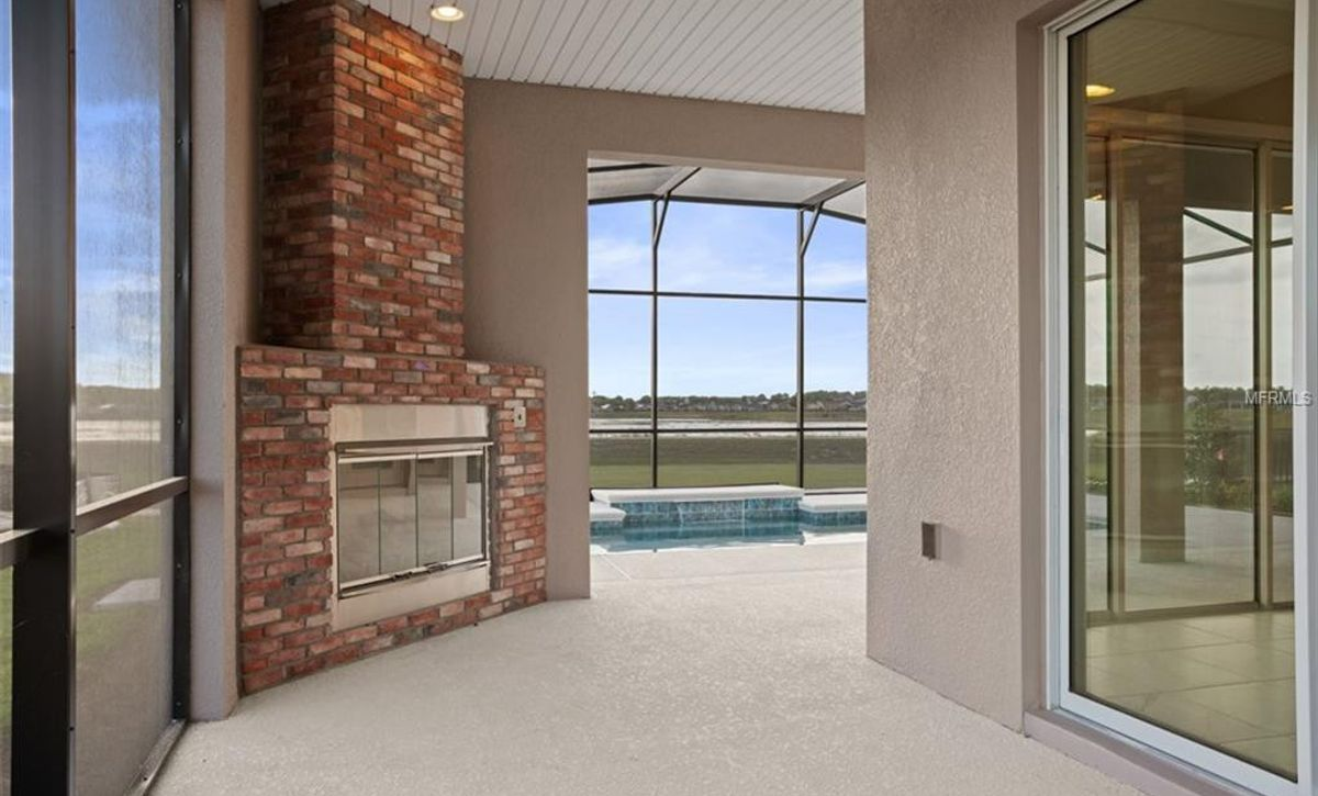 Trilogy Orlando Imagine Plan Quick Move In Home Covered Lanai with Fireplace
