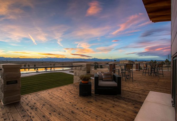 Exterior patio with outdoor furniture against sunset sky at the Overlook Amenity Center