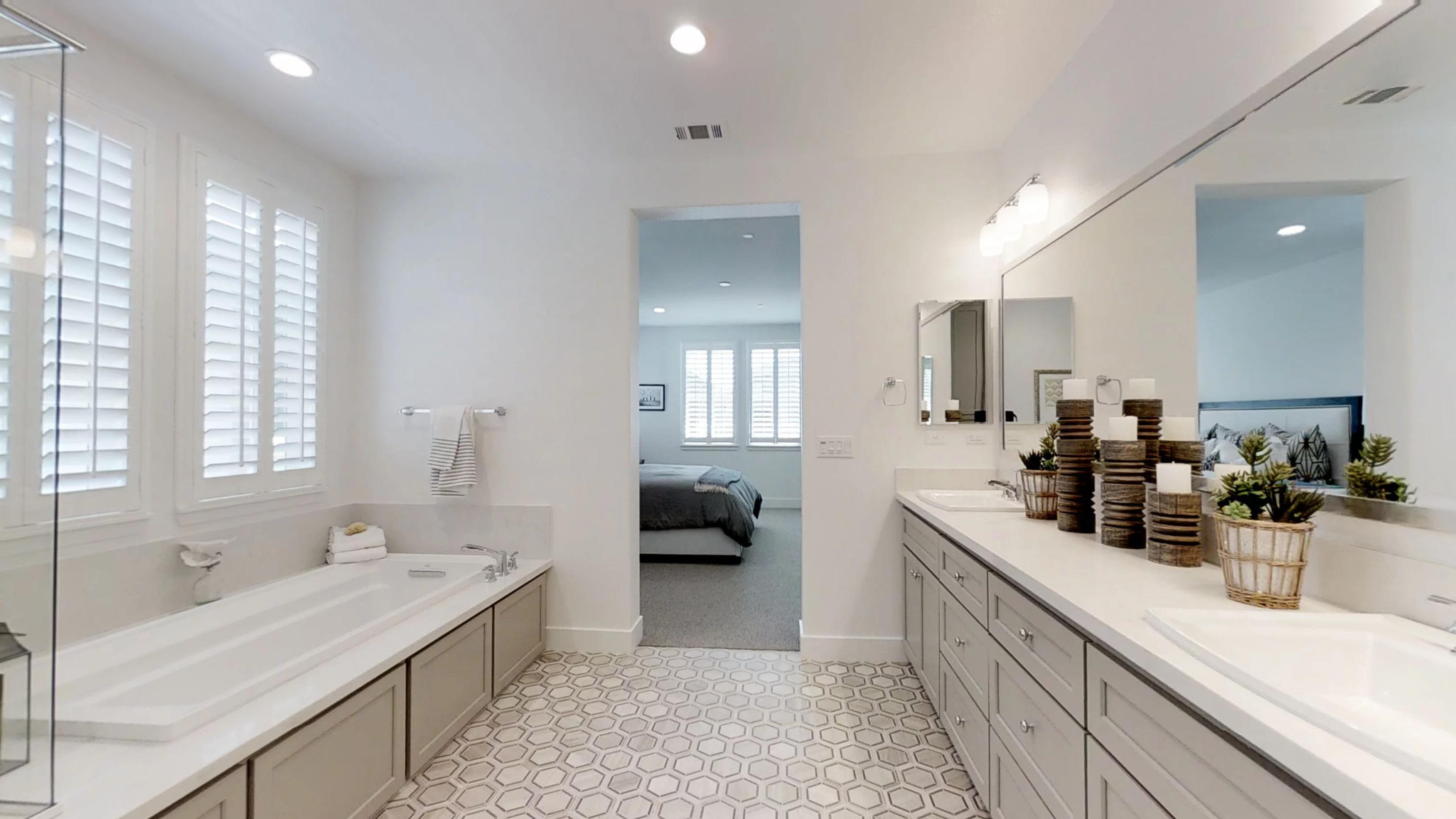 Plan 2 master bathroom with soaking tub, walk-in shower, and double vanity