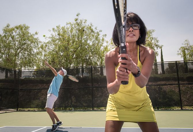 Homeowners Playing Tennis