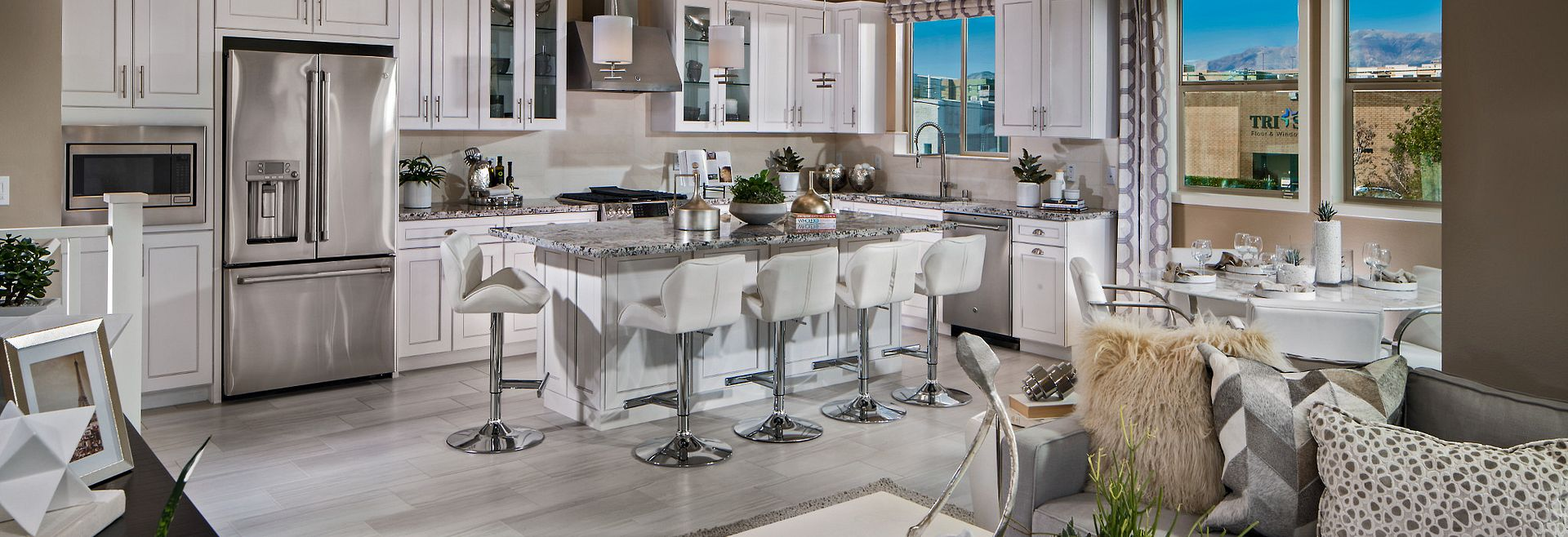 Residence 8 Kitchen with White Cabinets and Stainless Steel Appliances with Large Island