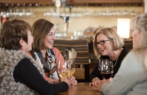Ladies having a glass of wine together