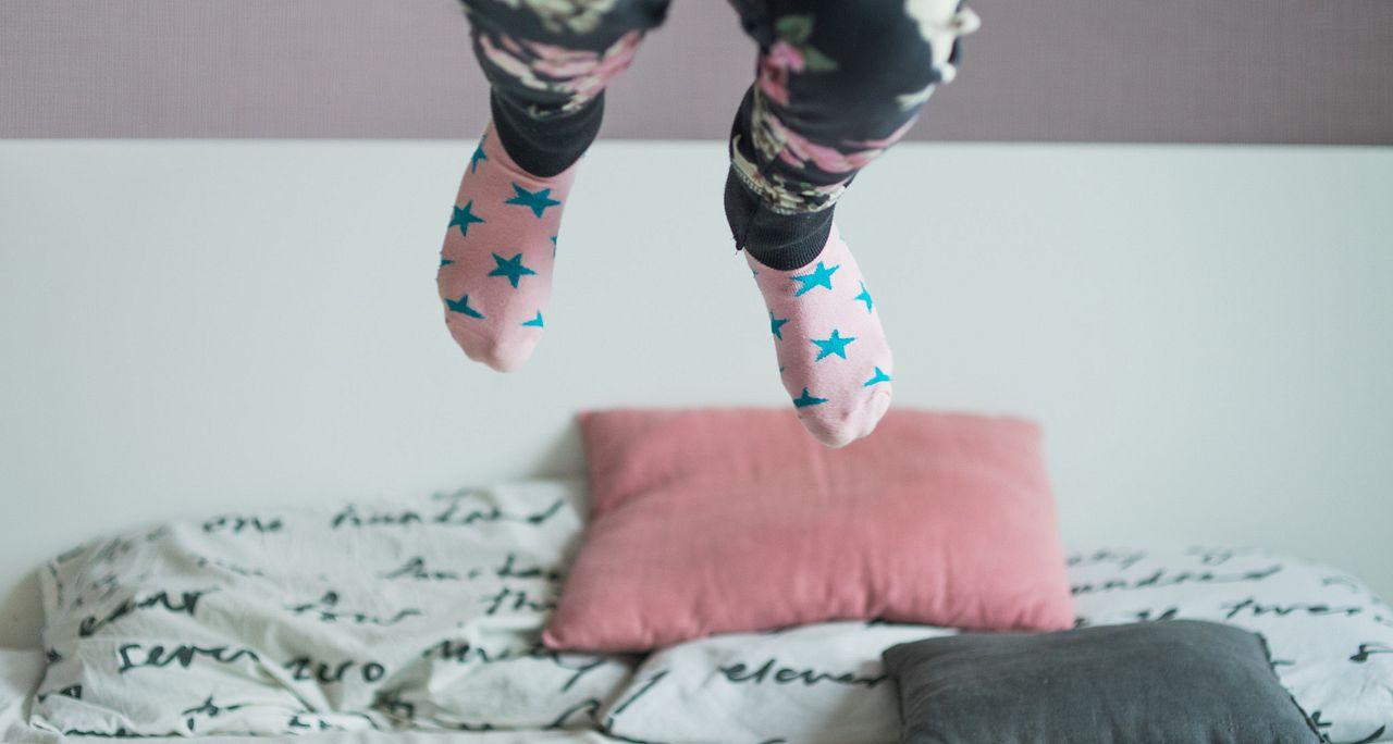 Childs feet jumping