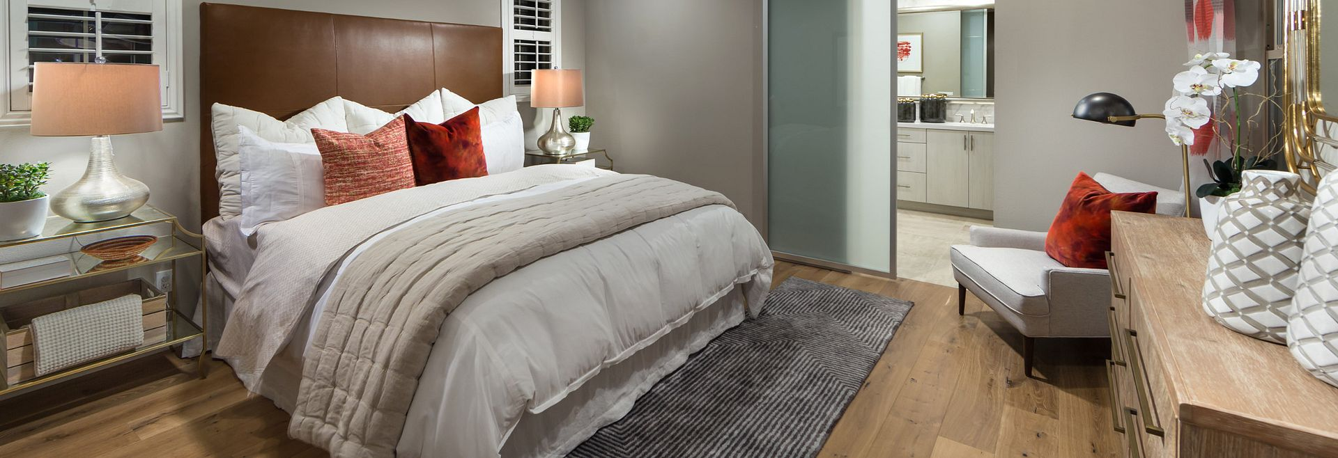 Master bedroom with bed, area rug, wood floors, recessed lights, night stands, and table lamps