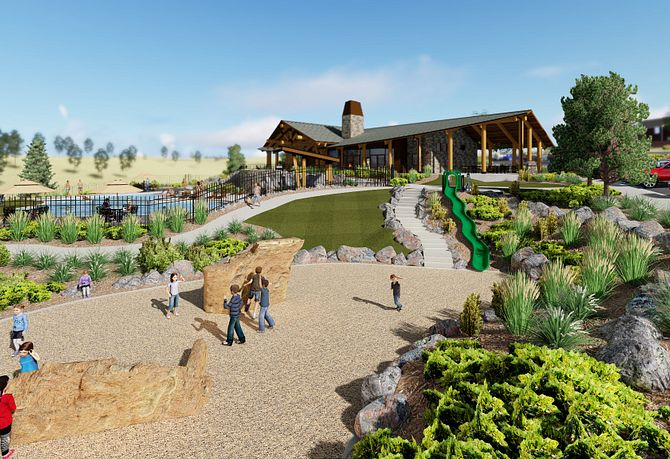 Exterior view of the Outlook Clubhouse with children playing in tot lot