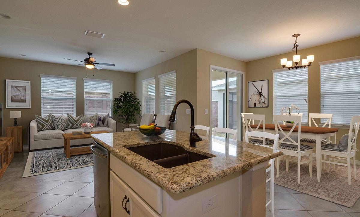 Trilogy at Ocala Preserve Quick Move In Home Virtually Staged Kitchen and Great Room
