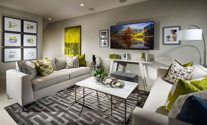 Plan 3 living room with television, area rug, two sofas, floor lamp, and coffee table