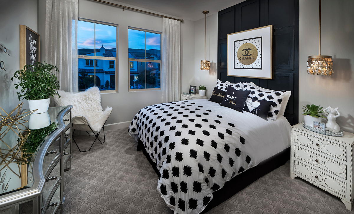 Plan 1 child's bedroom with bed, night stands, pendant lights, dresser, club chair, and windows with drapes