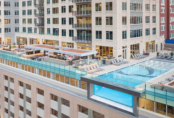 the quincy downtown denver apartments 8 story, glass-sided pool