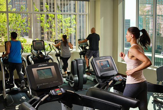 Fitness center with free weights and cardio machines the quincy downtown denver apartments