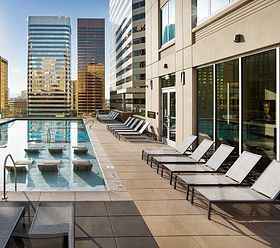 the quincy downtown denver apartments glass sided pool