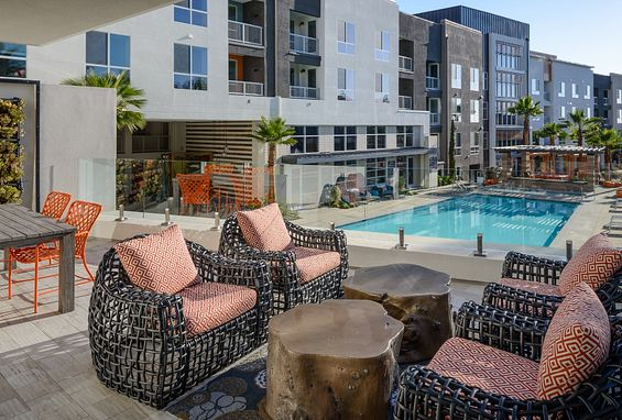Variety of seating areas by the pool at Vantis Apartments in Aliso Viejo, CA