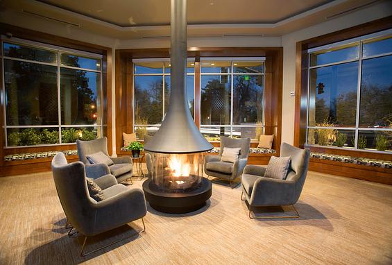 The york on city park apartments denver city park west amenity lobby fireplace