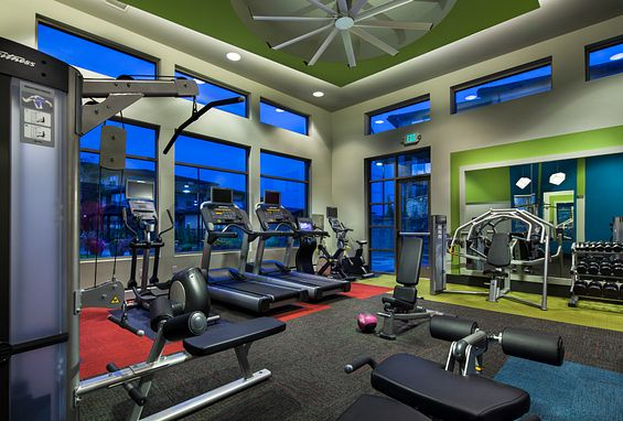 zenith meridian Englewood apartments fitness center with free weights and cardio equipment