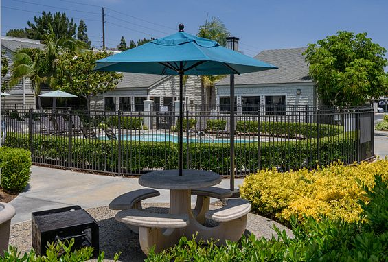 BBQ and picnic areas at Crystal Springs Apartments in Fountain Valley, CA
