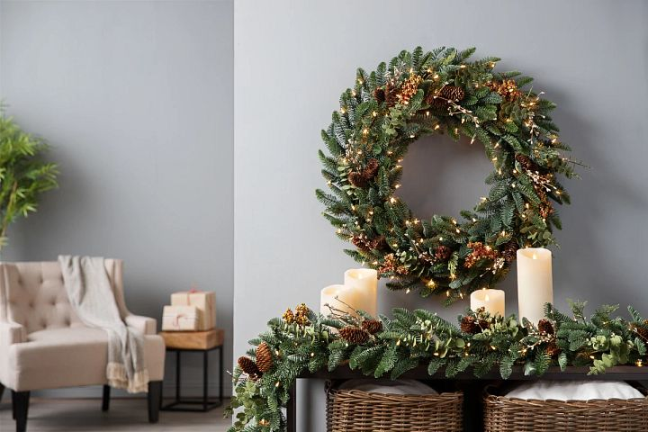 decorated greenery wreath and garland on a mantel