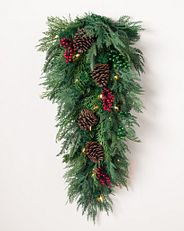 artificial greenery arrangement with decorations
