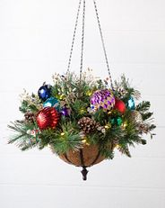 a hanging basket with artificial greenery and multicolored decorations