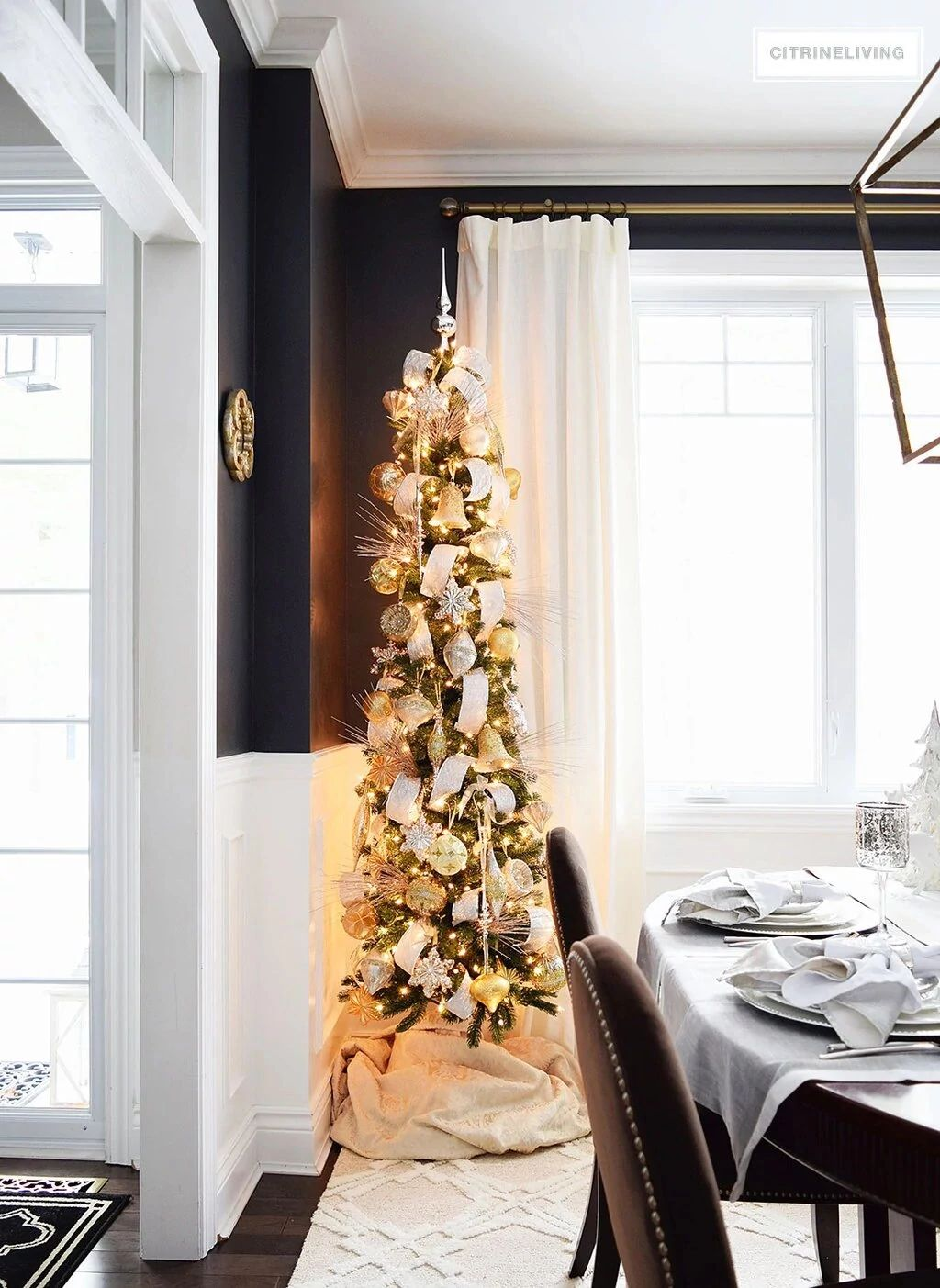 slim Christmas tree with decorations in the dining room