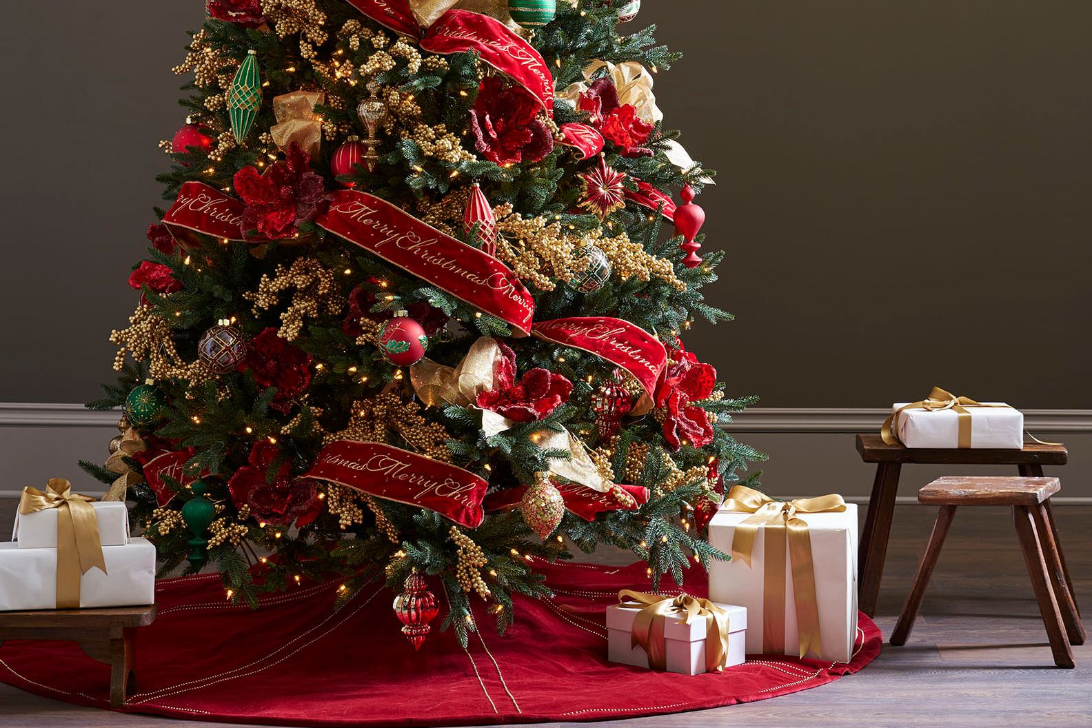 realistic artificial Christmas tree with red and gold decorations