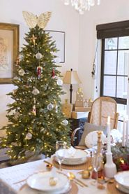 Balsam Hill's Silverado Slim tree decorated with white baubles and Christmas figurines