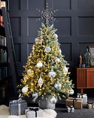 A Balsam Hill pre-lit Royal Blue Spruce tree decorated with white baubles