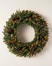 decorated greenery wreath with clear lights